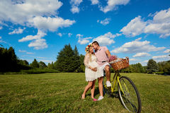 Man and a pregnant woman happy nature in park .Young happy famil Royalty Free Stock Images