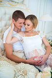 Man and pregnant woman happy together in anticipation of a child Stock Image