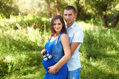 Man and pregnant woman in the park. The family. Stock Images