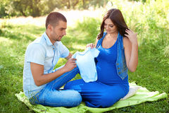 Man and pregnant woman in the park. The family. Royalty Free Stock Image