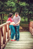 Man and Pregnant Woman in the Park Stock Photo