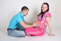 Man and pregnant woman sitting Royalty Free Stock Photo
