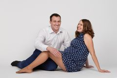 A man with a pregnant woman Royalty Free Stock Photos