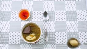 Man prepare chinese style food Fish Maw Soup with quail egg, chicken meat, and curdled blood of fowls.