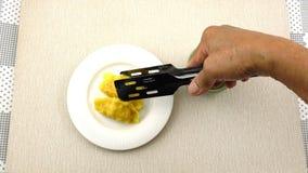 Man prepare Shrimp Wonton by using a metal tongs arrange them.