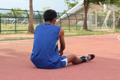 Man prepared running track for in the stadium. Stock Images