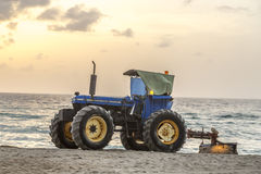 Man prepares the beach in early morning time Royalty Free Stock Photography