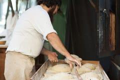 Man prepares the dough for baking bread. A man prepares the dough for baking bread stock images