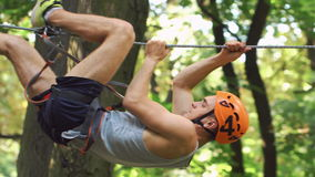 Man prepares for entertainment in the rope park stock footage