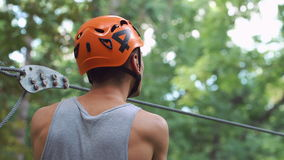 Man prepares for entertainment in the rope park stock video footage
