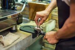 A Man prepares espresso royalty free stock photos