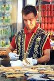 Man prepares fish bread Royalty Free Stock Image