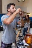 Man prepares a hookah Royalty Free Stock Image
