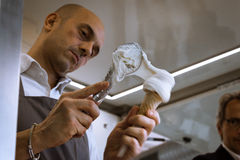 Man prepares an ice cream cone at Golosaria 2013 in Milan, Italy Stock Image