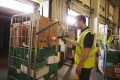 Man prepares and scans packages in a warehouse for delivery Stock Photography
