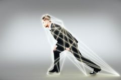 Man prepares to run in a digital interface Stock Photography