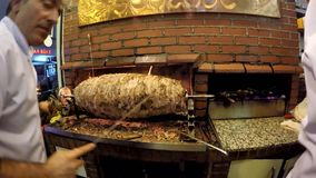 Man prepares turkish cag kebab on Sirkeci District in Istanbul, Turkey. ISTANBUL, TURKEY - DEC 12, 2015: Man prepares turkish cag kebab on Sirkeci District in stock video footage