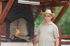 Man preparing barbecue. Senior man preparing barbecue Royalty Free Stock Photos