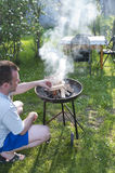 Man preparing barbecue Royalty Free Stock Photos