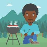 Man preparing barbecue. Stock Images