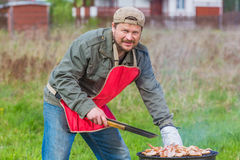 Man preparing barbecue Stock Photography