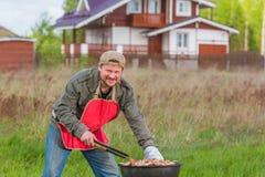 Man preparing barbecue Stock Image