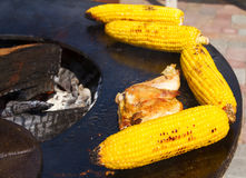 Man preparing barbecue outdoors. Cooking of grilled beef, chicken, corn and vegetables Stock Photography