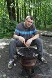 Man preparing barbecue Royalty Free Stock Image