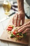 Man preparing big sandwich Stock Photos