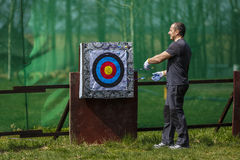 man preparing a bow and arrow shooting Stock Images