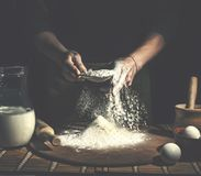 Man preparing bread dough on wooden table in a bakery close up. Preparation of Easter bread. Royalty Free Stock Images