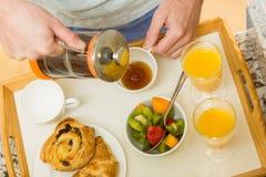 Man preparing a breakfast tray Royalty Free Stock Photos