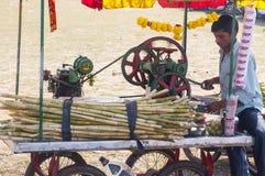 Man preparing cane sugar drink Royalty Free Stock Images