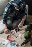 Man preparing cocaine lines Royalty Free Stock Image