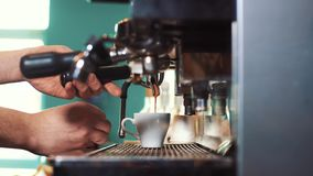 Man Preparing Coffee at Coffee Machine stock footage