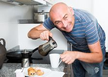 Man preparing coffee in moka pot in the kitchen. Ordinary man preparing coffee in moka pot in the kitchen stock photography