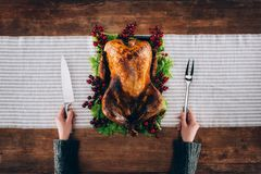 Man preparing cut baked turkey Royalty Free Stock Photography