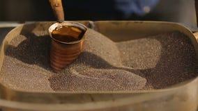 Man preparing delicious aromatic coffee sand Turkish method, traditional treat. Stock footage stock video footage