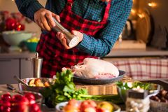 Man preparing delicious and healthy food in the home kitchen for christmas Christmas Duck or Goose.  stock image