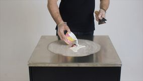 Man preparing dessert. Clip. Chef prepares a delicious dessert based on milk royalty free stock photography
