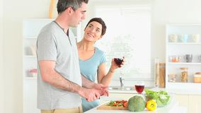 Man preparing dinner while woman is watching stock video