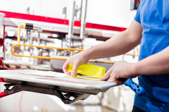 Man preparing fabric for screen printing. Royalty Free Stock Photo