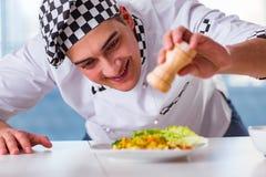 The man preparing food at the kitchen Stock Photos