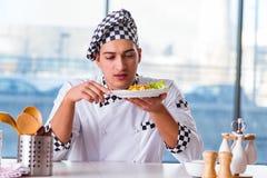 The man preparing food at the kitchen Royalty Free Stock Photo