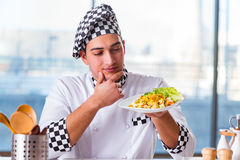 The man preparing food at the kitchen Stock Image