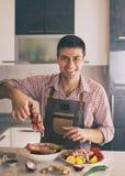 Man preparing food in kitchen stock photos