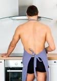 Man preparing food in the kitchen. Stock Image