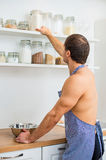 Man preparing food in the kitchen. Stock Photography