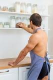 Man preparing food in the kitchen. Stock Photos
