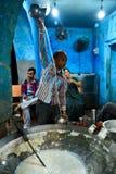 Man preparing glass of hot milk Royalty Free Stock Photos